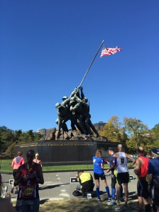 runners getting their picture taken at Iwo Jima Memorial at the finish